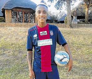 Former Tornado midfielder, Thabiso 'Forlan' Mikaele, shows off his new playing kit after signing for National First Division side TS Galaxy during a meet and greet in KwaNdebele