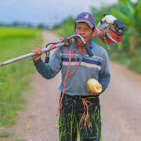 The rice farmer. by John Greene - People Portraits of Men ( grass, countryside, thailand, rural, strimmer, farmer )