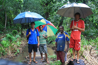Photo: Making our way to the bus to go back to Savu Savu in the pouring rain