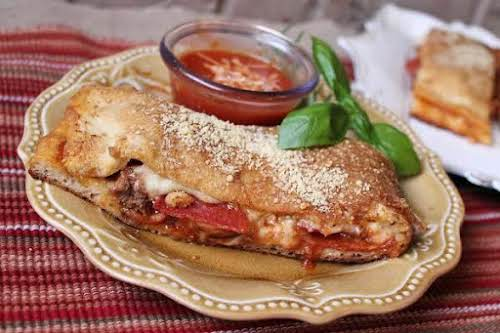 """Spicy Calzone """"No need for takeout when you can make delicious calzones..."""