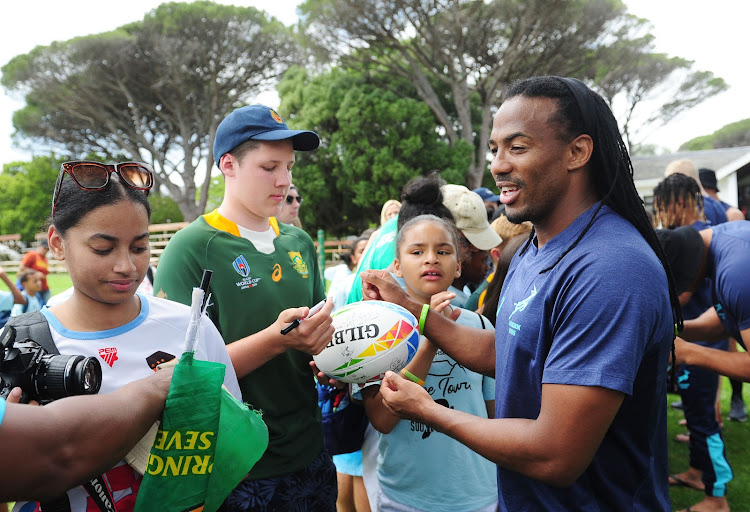 Cecil Afrika signs autographs after the Cape Town Sevens training session at Bishops High School in Cape Town on December 10 2019.