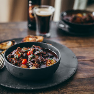 Porter Oxtail Potjie With Braaied Spuds