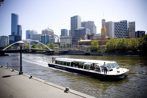 Melbourne-Yarra-riverboat - A cruise boat sails on the Yarra River in the Southbank section of Melbourne, Australia.