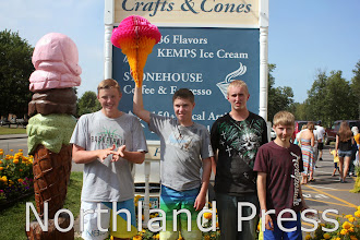 Photo: The age 13-16 division of the Lake Country Crafts and Cones Ice Cream Eating Contest had four winners, with two competitors tying for third place. In first is Tommy Harald (second from left), 16, of St. Michael; in second is Michael Voss (far left), 16, of St. Michael; and tying for third is Cameron Steffen (far right), 14, of Crosslake, and Alex Dahlen (second from right), 16, of Hartland, Minn. -photo by Kate Perkins