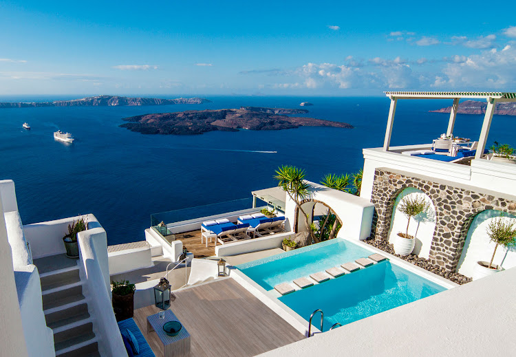 The view from Iconic Santorini, a 22-room boutique hotel on the rim of the caldera.