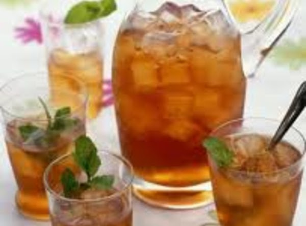 Strain tea into serving pitcher. Stir in ice cubes until melted. Serve in tall...