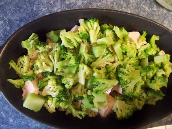 Layer chopped broccoli on top of the cut chicken