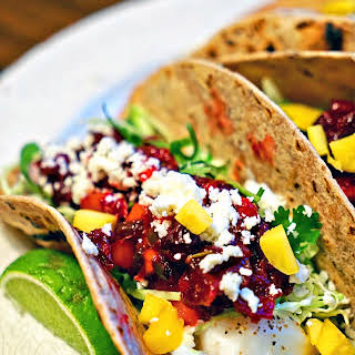 Grilled Fish Tacos with Roasted Cranberry Mango Salsa.
