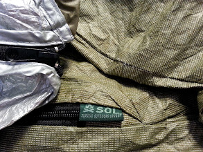 Photo: Some nice details such as nice finished seems on the inside, and a dart at the end of the 1/4 length zipper. Six foot four 235lbs for 2 nights really pushes out on the bag and the seems only settled a  little bit.