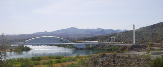 Photo: The beautiful white bridge.  It is being sand blasted and painted, so it is covered in plastic