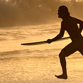 SUrfer sunning by Cristobal Garciaferro Rubio - People Portraits of Men ( water, pwcsilhouettemotion, surferm running, sunset, runner )