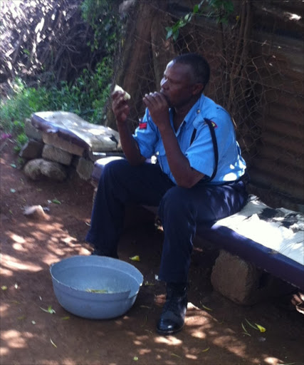 A police officer chews sugarcane in Kisumu. Wholefoods make you healthy