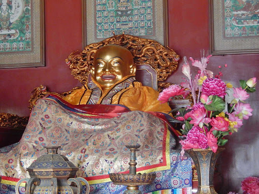 Golden Buddha with Silk Quilt in the Jiaodaokou district of Beijing.
