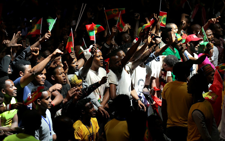 People hold Oromo Liberation Front (OLF) flags as they celebrate the returning of Jawar Mohammed, US-based Oromo activist and protest leader, in Addis Ababa, Ethiopia on August 5 2018.