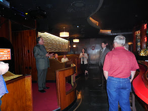 Photo: President Rasch welcomes the alumni employees to a reception at the Cavalier Lounge.