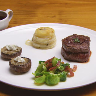 Beef With Red Wine Sauce, Vegetables, Prosciutto & Goats Cheese Stuffed Mushrooms.