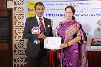 Photo: Prof. Dr. R. Ganesan, Chairman, NFED Issuing Certificate of Appreciation To Prof. Dr. S. Apitha, Presidium Member of NFED at Entrepreneurs' Day Awards '2014