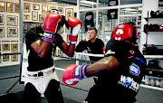 Damien Durandt watches two boxes in a sparring session.