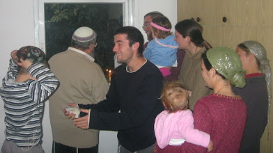 Photo: Lighting the 6th Candle of Hanuka Together