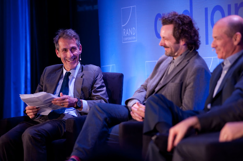 "Photo: Moderator Michael Lynton shares a laugh with panelist Michael Sheen during the  ""Hollywood and Policy"" panel discussion Friday, Nov. 16 at the RAND Politics Aside event in Santa Monica."
