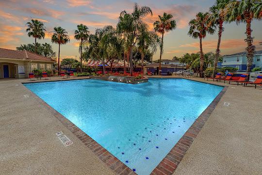 Harbor House on Saratoga apartment swimming pool at dusk