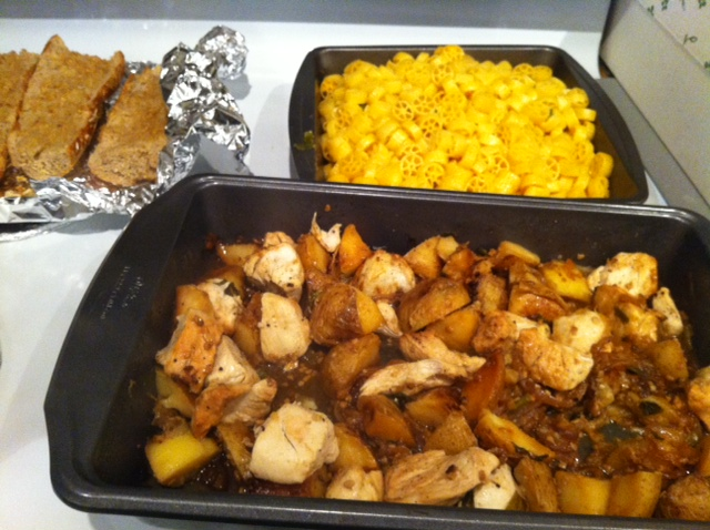 Photo: Roasted chicken and potatoes, homemade mac and cheese, fresh garlic bread