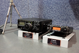 Photo: A pair of portable Yaesu HF/6m transceivers.  On the left is the FT-897D and on the right is the FT-857D.  I used to own the 897.