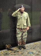 Photo: Unidentified Vietnam Vet leaving boots as a remembrance