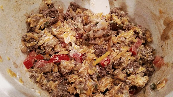 In a small skillet, saute onion, jalapeño and ground beef, until beef is no...