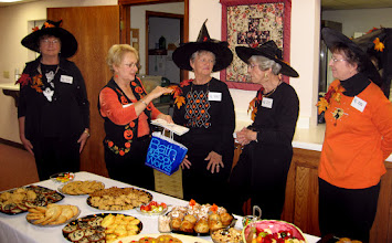 Photo: The Bewitching Hostesses Setting up the Food