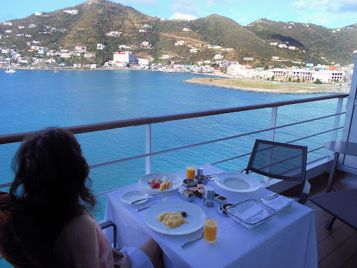 Patti breakfast in Tortola.jpg - Isn't this a great way to have your breakfast? We got to take in the marina of Port Purcell in Tortola to start our day.