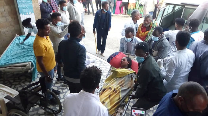 A woman is taken to Ayder Referral Hospital, in Mekelle, after an airstrike in Togoga, Ethiopia's Tigray region on June 22, 2021.