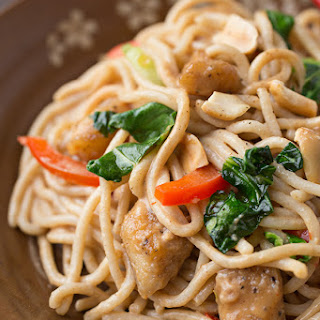 Peanut Chicken with Baby Bok Choy & Red Bell Peppers over Brown Rice Noodles.