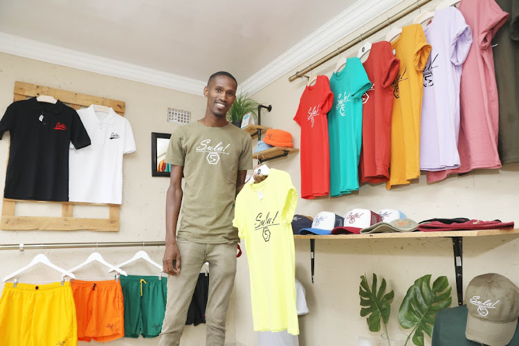 Vusumuzi Makhubo founder and owner of Sula Lifestyle clothing brand in Phiri, Soweto.
