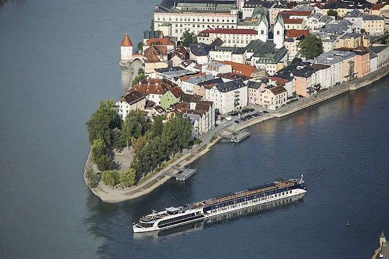 An aerial shot of the luxury river ship AmaStella sailing in Passau, Germany.