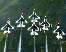 Photo: EIELSON AIR FORCE BASE, Alaska -- The Thunderbird aerial demonstration team performs a loop while in the famous Delta formation here. (U.S. Air Force photo by Tech. Sgt. Sean M. White)