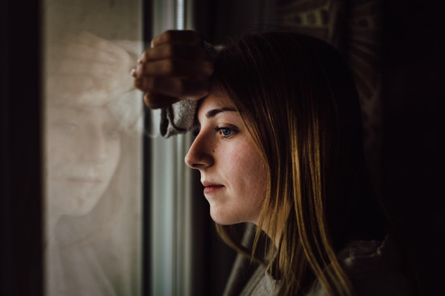 girl looking outside window