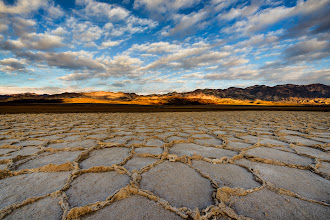 Photo: Deep In The Shadows  If you look real close you can see our rental cars hidden in the shadows. This was from a trip to Death Valley last winter. We were out playing in these fantastic formations in the Badwater Basin waiting for the sun to set when I looked behind me and saw the sun partially lighting up the mountains behind us. I loved this place and am dying to go back again someday.  #dvonewaytrip2013