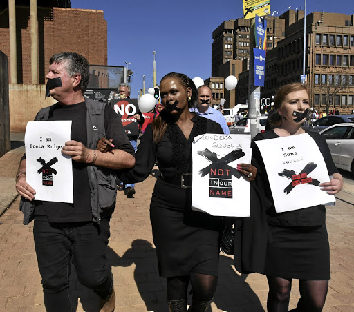 Voiceless: Foeta Krige, left, Thandeka Gqubule and Suna Venter protest after being suspended for questioning SABC policy. Venter died in June, of a stress-related ailment. Picture: FREDDY MAVUNDA