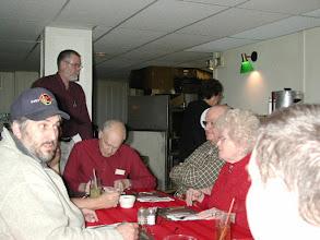 Photo: Gary N7RMS, standing Jim KD7AKN, writing Don W7DRF, Eldon W7UAS,  and his XYL