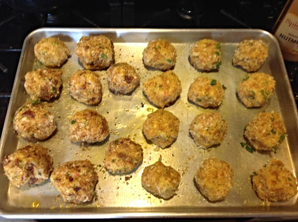 Dunk each potato ball into beaten egg mixture then roll into bread crumb mixture,...