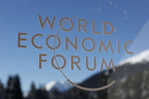 A logo sits on a window at the entrance hall of the Congress Center on the opening day of the World Economic Forum (WEF) in Davos, Switzerland, on Tuesday, January 22 2019. Picture: GETTY IMAGES/ BLOOMBERG/ JASON ALDEN