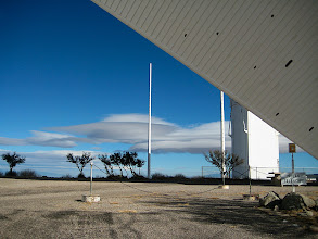 Photo: Lenticular clouds near Kitt Peak, Az, viewed under the arm of the McMath Solar Tower.  The clouds held in position for at least 30 minutes, but changed in form on timescales of a few (5?) minutes.  In the distance I could see many similar, but smaller, clouds.  A bit like giant white UFOs lurking behind the telescope.