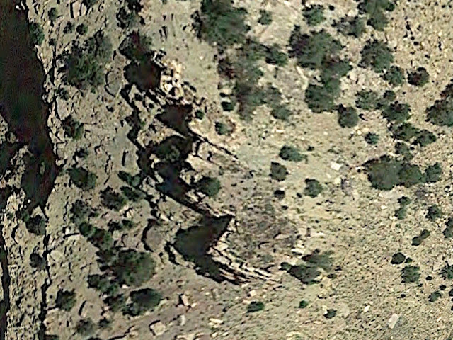 Satellite image showing a faint circle of rocks
