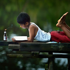 a d i t by Dody Herawan - Babies & Children Child Portraits ( reading, mood, study, boy, portrait, human )