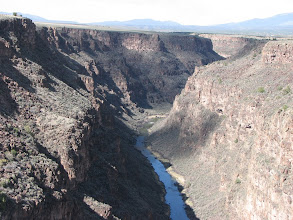 Photo: Starting as a mountain stream in Colorado, the Rio Grande undergoes several dramatic transformations.  Between here and Santa Fe the valley widens and we drove along the river.  In some places there the valley was wide enough for small ranches and settlements.  Not here!
