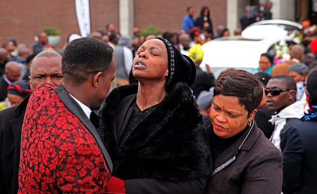 Khensani Maseko's mother, Thobile Thembi Maseko, weeps as her daughter's body is laid to rest at Nasrec Memorial Park, south of Johannesburg. Khensani' 23, a third-year Rhodes University student ' committed suicide last week