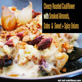 Cheezy Roasted Cauliflower. Vegan. Plant-based and gluten-free. Made with 4 minute cheeze sauce (cheese sauce), smoked almonds, dates and sweet & spicy onions..