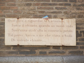 Photo: The second of the two towers, Garisenda, is mentioned in Dante's Inferno. The quote is on a plaque mounted on the side of the tower.