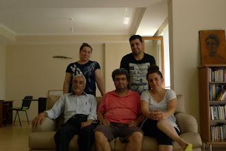 Photo: Resul Geyik (in the centre) with his familly in Diyarbakir, 2015. Resul is English/Kurdish  simultaneous translator and English lanuage teacher at the Mardin Artuklu University where the first Kurdish language department in Turkey has been opened.